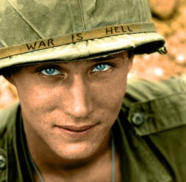 An American soldier wears a hand lettered War Is Hell slogan on his helmet, Vietnam, 1965 3